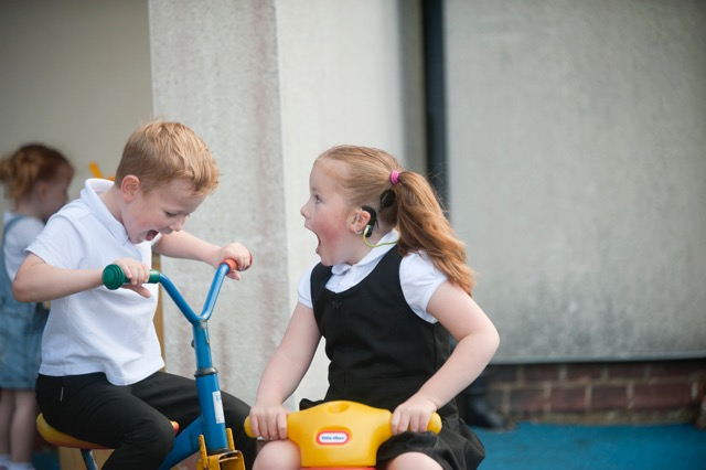 deaf children playing on bikes
